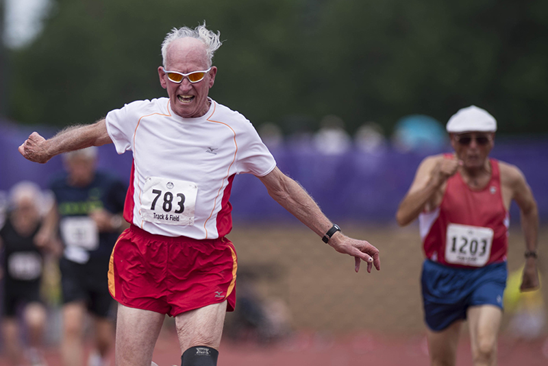 Melvin Larsen takes first place in the mens 100 meter race at the National Senior Games at the University of St. Thomas in St. Paul MN., on July 9, 2015 (© Rebekah A. Romero 2015)